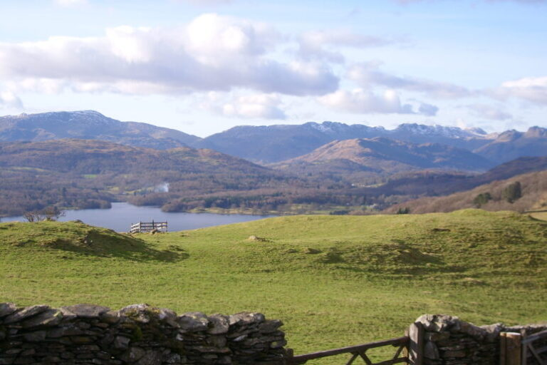 A walk form Windermere to Ambleside showing a view across Windermere lake towards the Coniston and Langdale fells